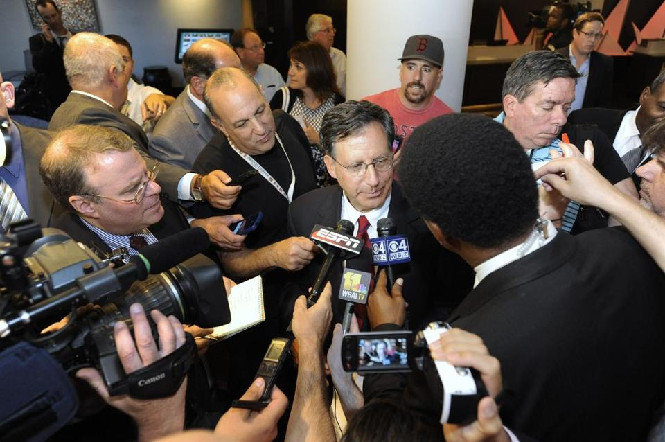 Tom Werner, center, spoke to reporters after Rob Manfred's election.