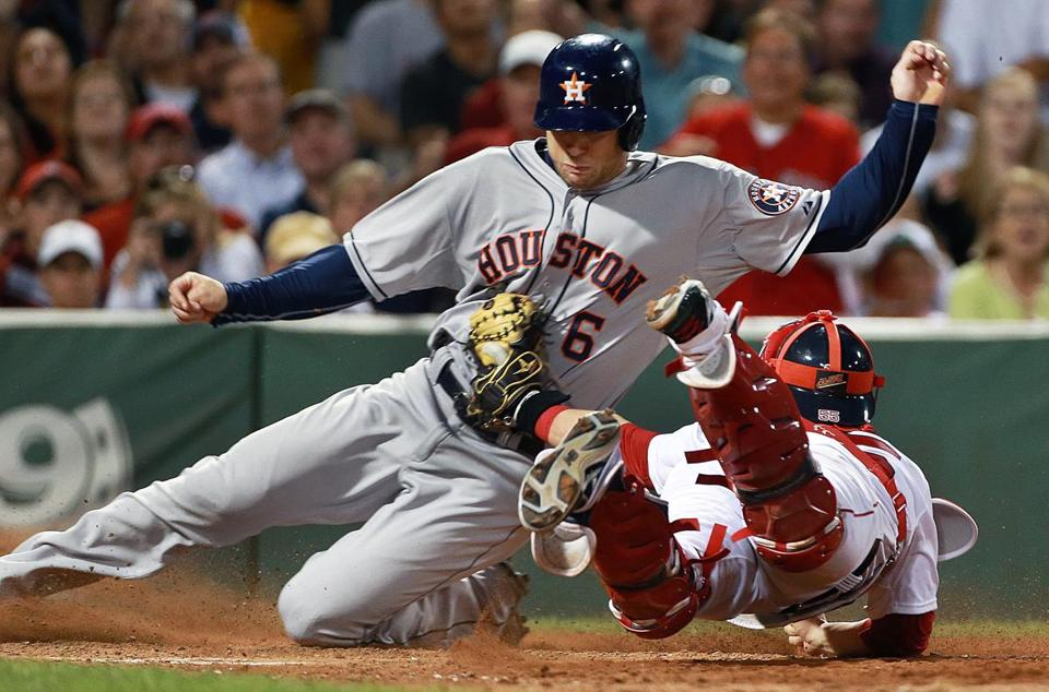 Red Sox catcher Christian Vazquez dove to tag out Houston's Jake Marisnick in the 7th inning.