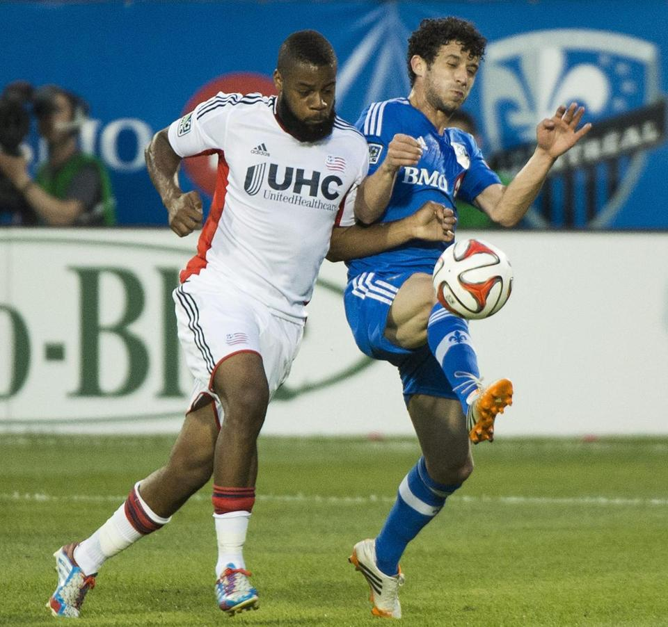 The Revolution's Andrew Farrell (left) doesn't mind getting physical on the field. (AP Photo/The Canadian Press, Graham Hughes)
