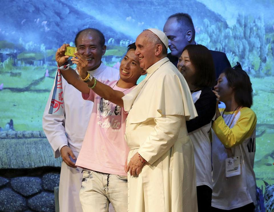 Pope Francis posed for a selfie during a meeting with Asian youth in South Korea.