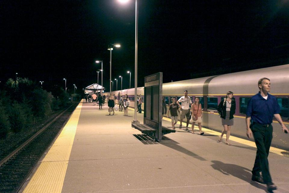 "Commuters leave the 10:30 p.m. train at the Newburyport commuter rail station. ""This is one of the worst stations,"" one rider said."
