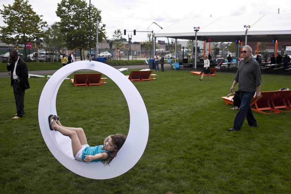 Guests enjoy large art interactive pieces at the Lawn on D grand opening in South Boston earlier this month.