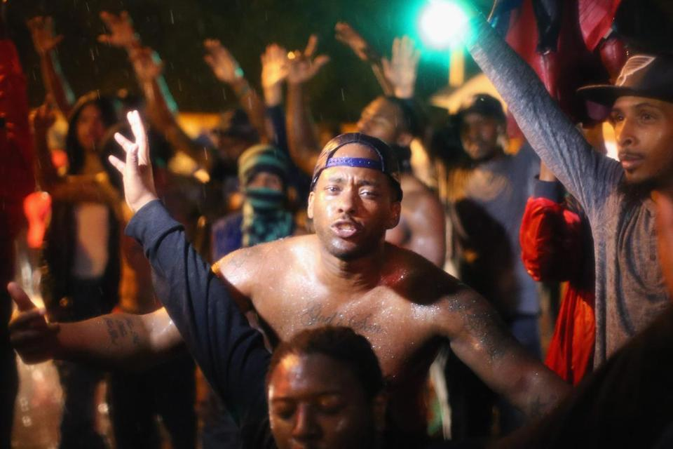 Demonstrators violated Ferguson's curfew and remained on the streets early Sunday.