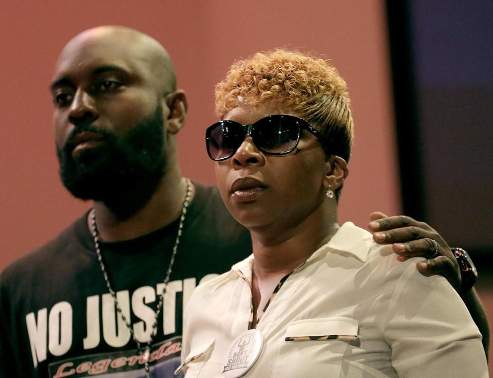 Michael Brown Sr. and Lesley McSpadden, the parents of Michael Brown, listened to a speaker during a rally Sunday in Ferguson.
