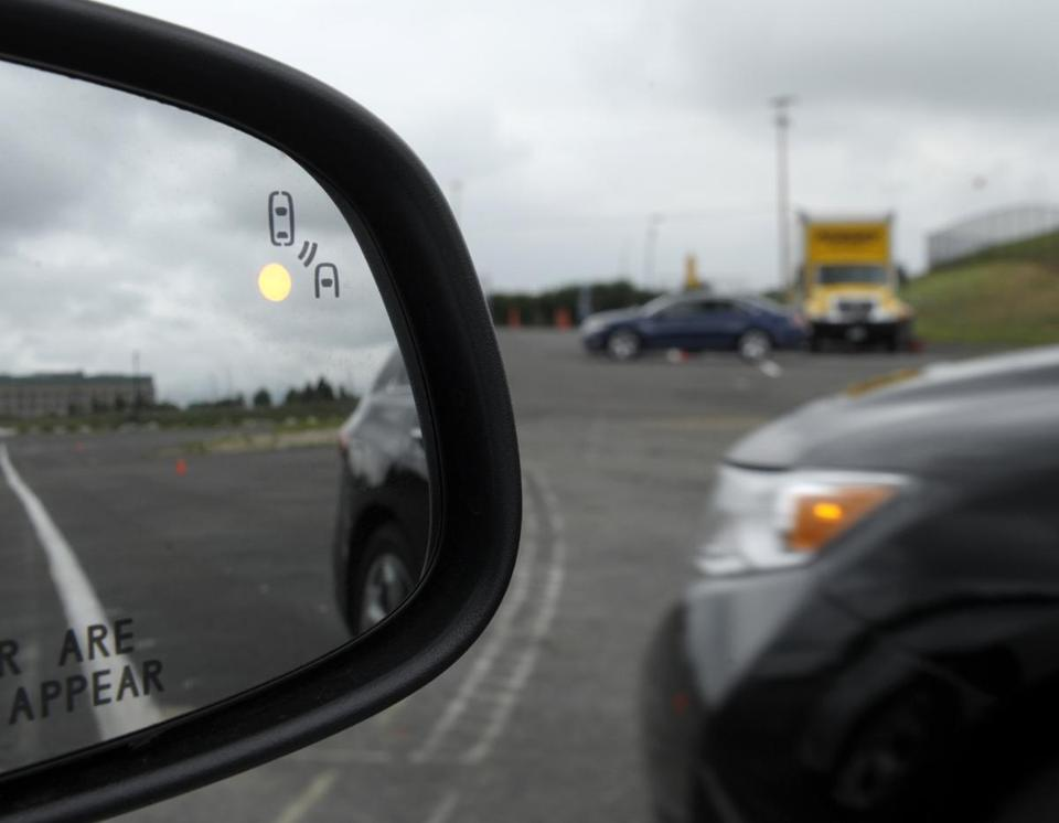 A side-mirror warning signal is one tool that can be used in crash-avoidance systems. The Obama administration is taking the first step toward requiring such gear in new cars.