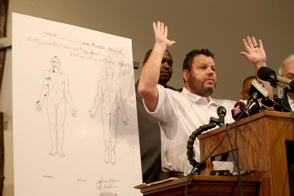 Shawn Parcells, a forensic pathologist who assisted in the autopsy of Michael Brown, spoke during a press conference Monday in Ferguson, Mo.