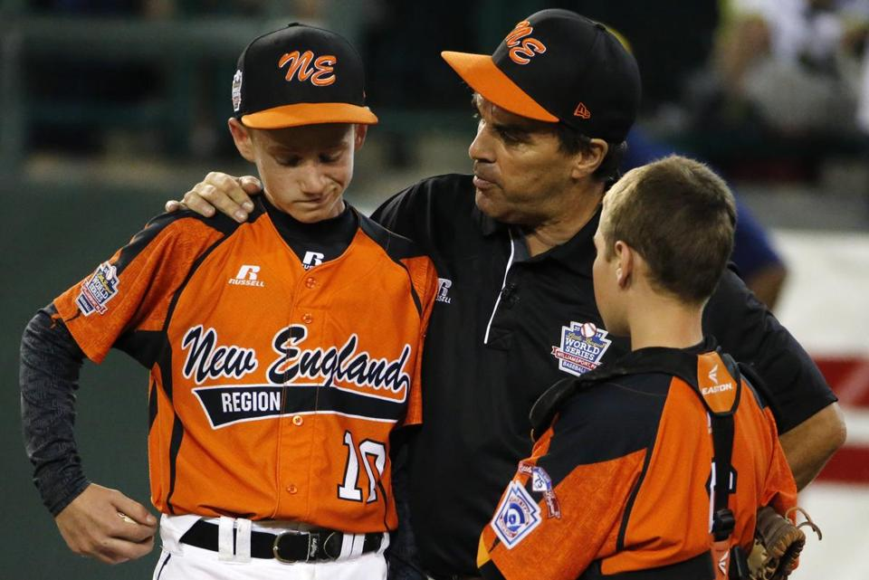 Cumberland manager David Belisle, center, talks with pitcher CJ Davock, left, and catcher Trey Bourque during the fifth inning of an elimination game in the Little League World Series Monday.