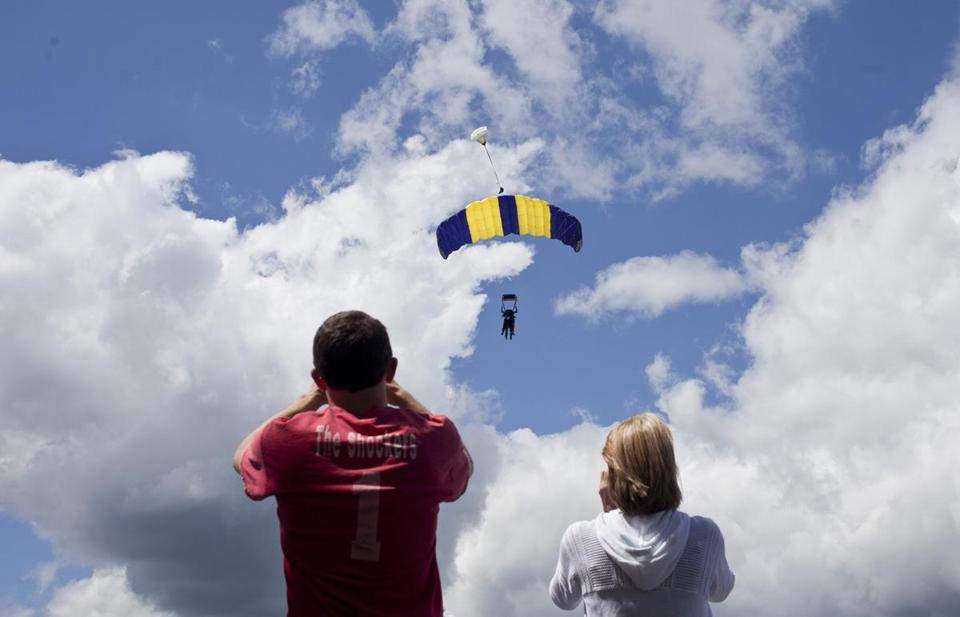 8/17/14 Orange, Mass. Spectators watch skydivers through cameras and binoculars on Sunday morning, August 17, 2014 at Jumptown in Orange, Mass. (Zack Wittman for the Boston Globe)