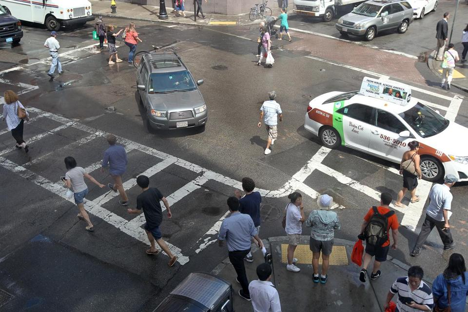 Pedestrians crossed at Beach Street and Harrison Avenue in Chinatown.