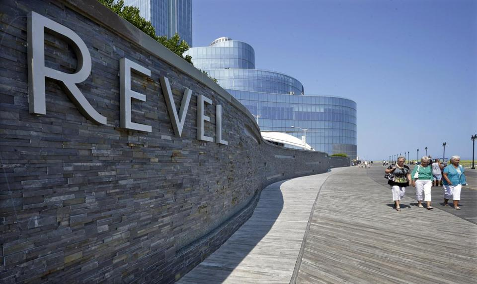 People walked past the Revel Casino Hotel in Atlantic City, N.J.