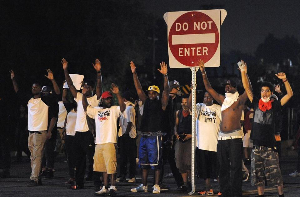 Demonstrators gestured during a protest on West Florissant Avenue in Ferguson, Mo., on Monday.