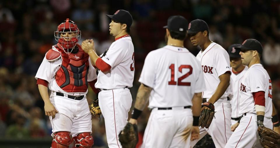 Red Sox relief pitcher Junichi Tazawa's throwing error allowed two runs to score in the eighth inning.