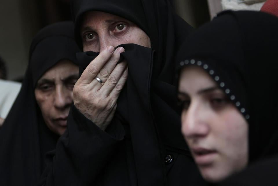 Relatives grieved for Widad Mustafa Deif, wife of Hamas's military leader, at her funeral in Gaza on Wednesday. Deif and her 8-month-old son died in an Israeli airstrike Tuesday.