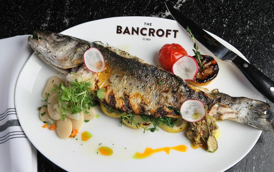 Whole grilled branzino with green olive and caper relish.