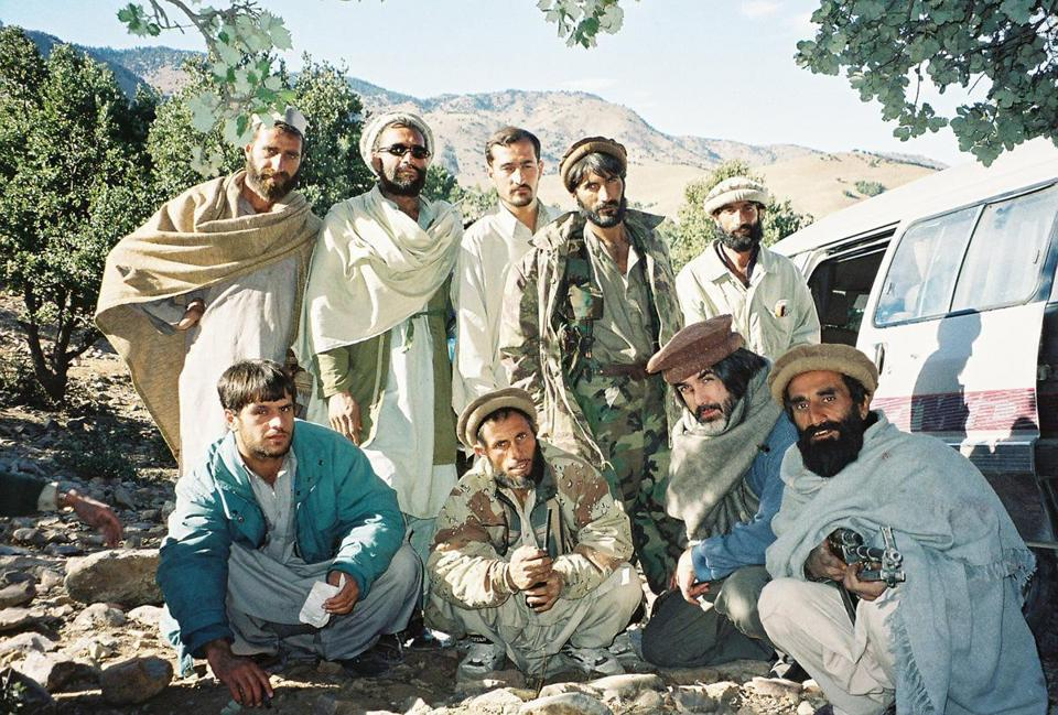 David Filipov (seated third from left) wore local garb to fit in better while reporting in Tora Bora in 2001 with a Pashtun militia helping American forces hunt Osama bin Laden.
