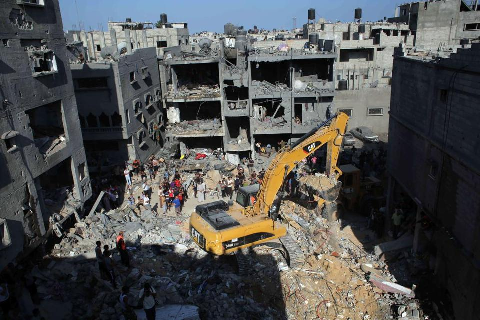 Palestinian emergency personnel went through the rubble of a building destroyed following an Israeli military strike in Rafah, Gaza Strip, on Thursday.
