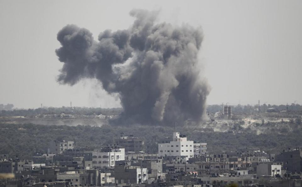 Smoke was seen following what witnesses said was an Israeli airstrike in Gaza on Thursday.