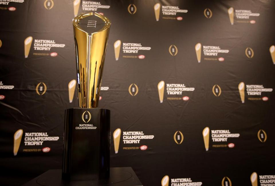 The new top prize in college football's highest level is a gold football-shaped trophy.