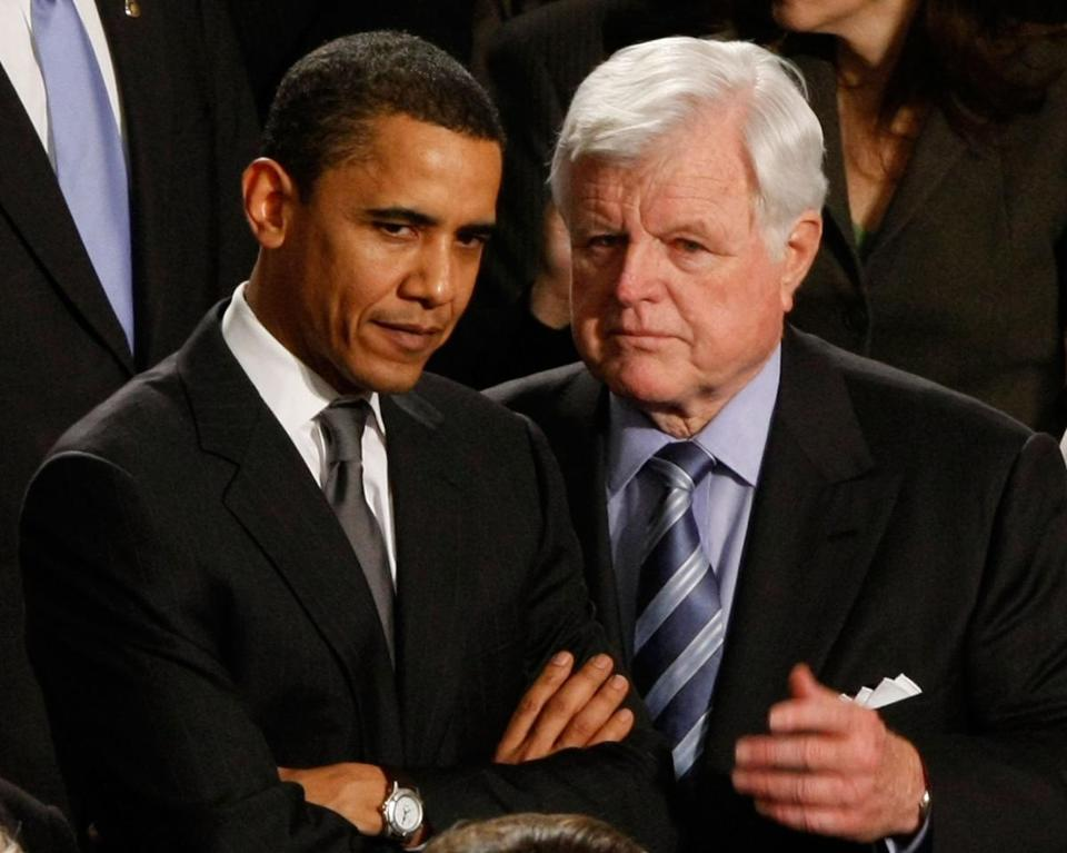 Then-presidential candidate Barack Obama confers with Senator Ted Kennedy in January 2008.
