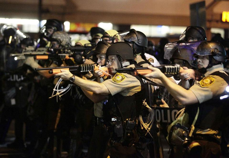 Earlier this month, police officers pointed their weapons at demonstrators protesting the shooting death of Michael Brown in Ferguson, Mo.