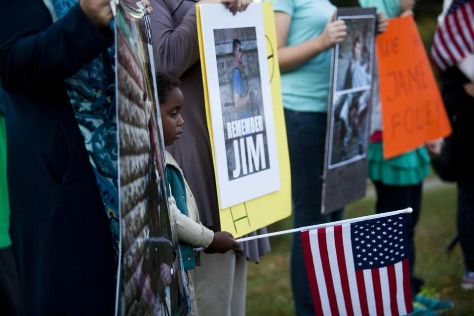 More than 200 people gathered in Rochester, N.H., for a vigil in honor of James Foley, killed by Islamic State militants.