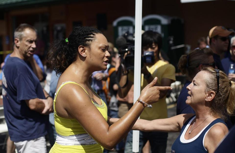 Sondra Fifer (left) confronted a demonstrator supporting Ferguson police Officer Darren Wilson during a rally in St. Louis. The St. Louis County NAACP also held a youth march to the site where Michael Brown was killed.