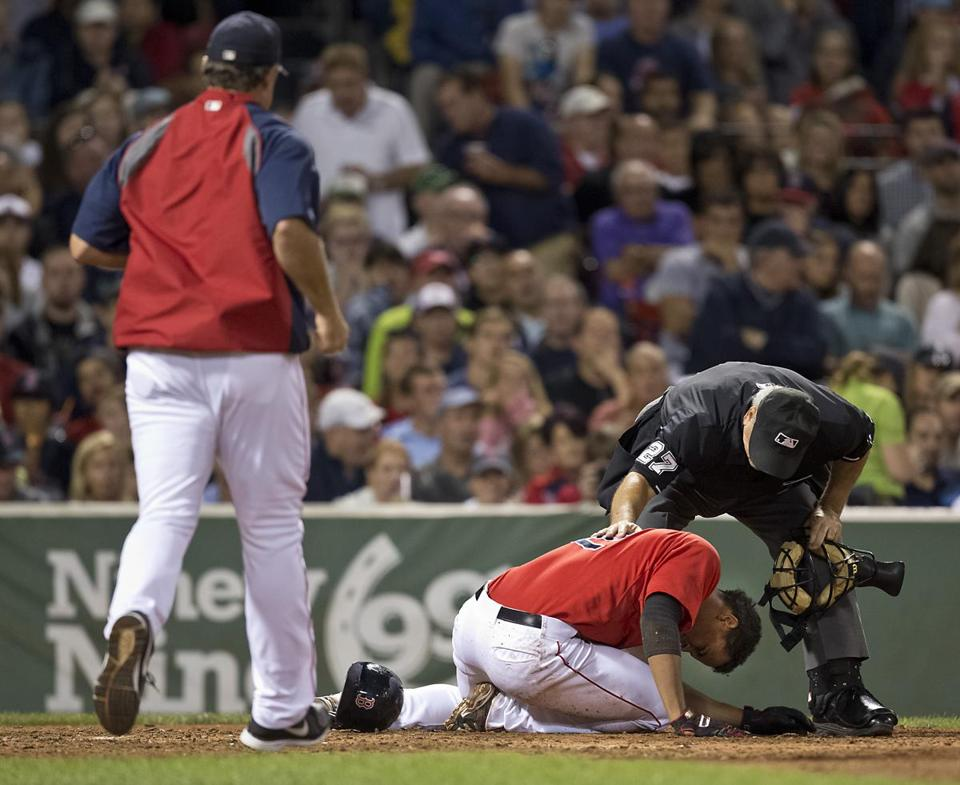 Xander Bogaerts held his head after being dropped by a Felix Hernandez pitch.