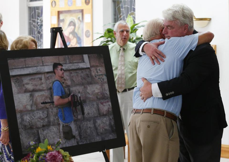 John Foley, James Foley's father, received a hug after Sunday afternoon's Mass.