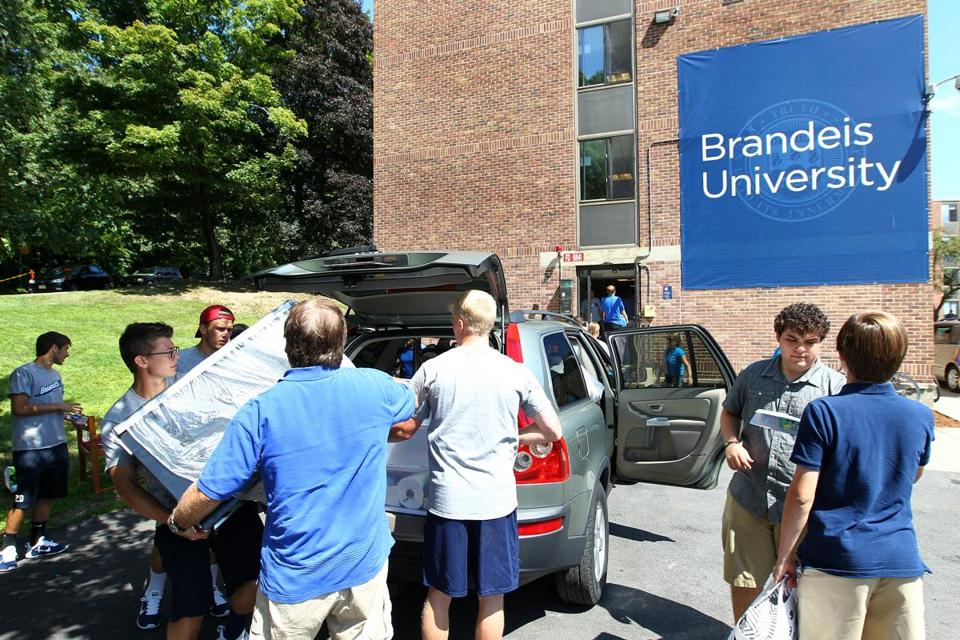 Sunday was move-in day as first-year students arrived at Brandeis. Ian Schein helped unload  items for his daughter Michelle.