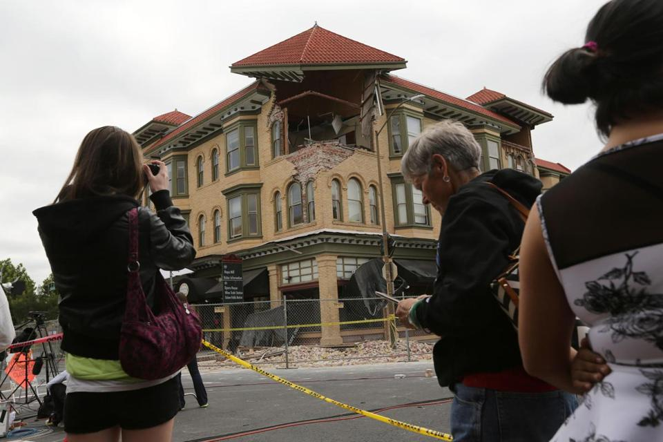 A building damaged in Napa, Calif, damaged by Sunday's earthquake was the subject of attention Monday.