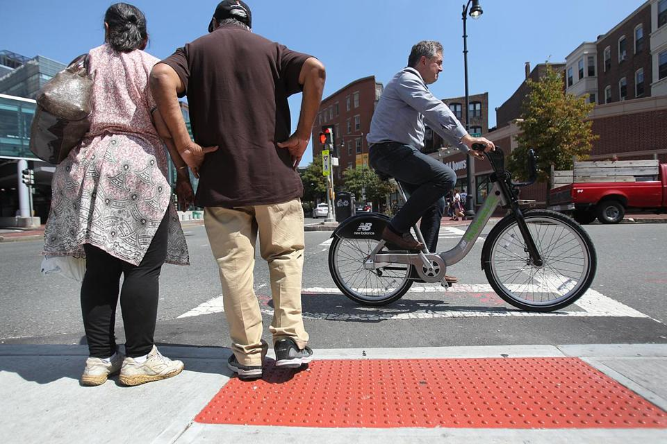 Pedestrians crossing Charles Circle on Tuesday said they did not understand how the new ramps could be controversial.