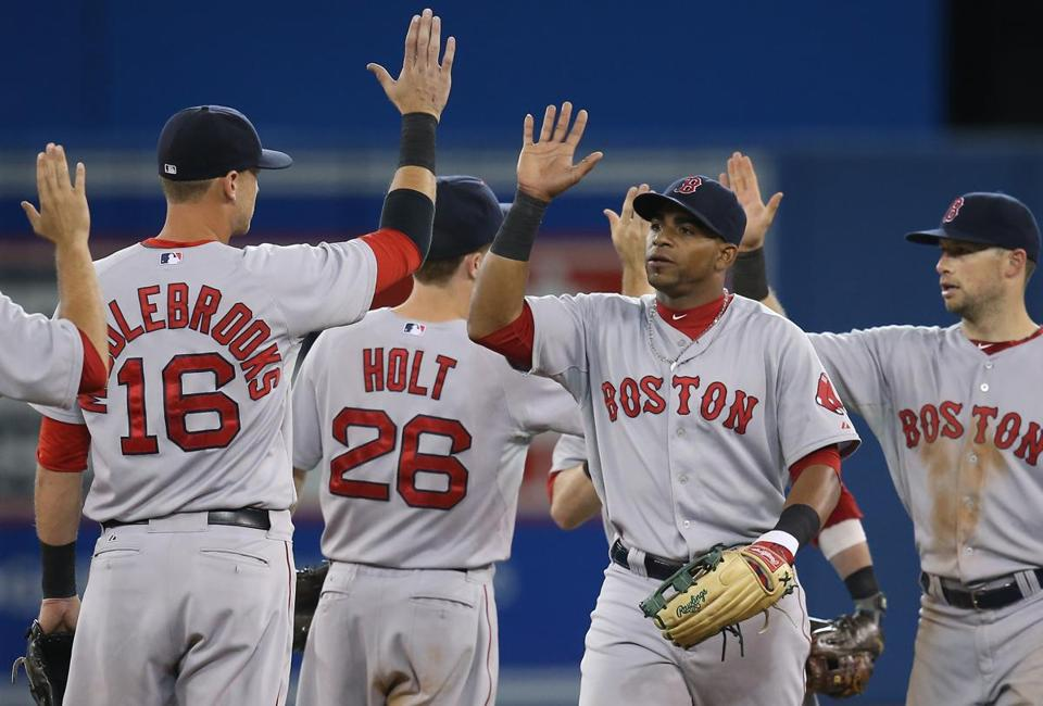 Yoenis Cespedes, center, drove in the winning run before the Red Sox celebrated Monday's win.