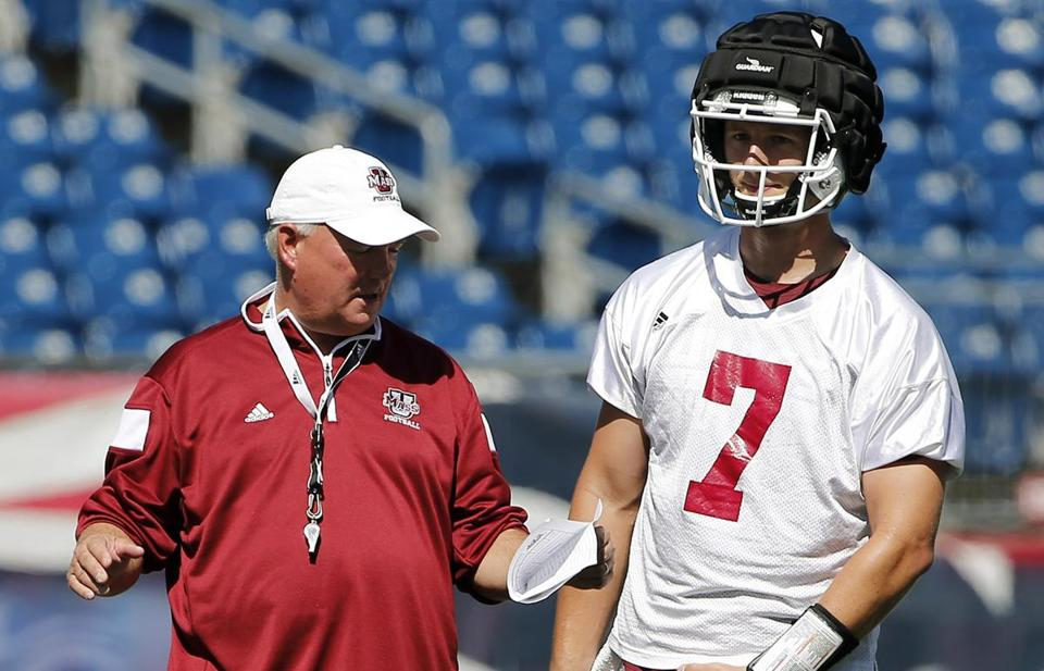 Coach Mark Whipple, who led UMass to the NCAA Division 1-AA national title in 1998, will try to guide quarterback Blake Frohnapfel and the Minutemen to new heights once again.