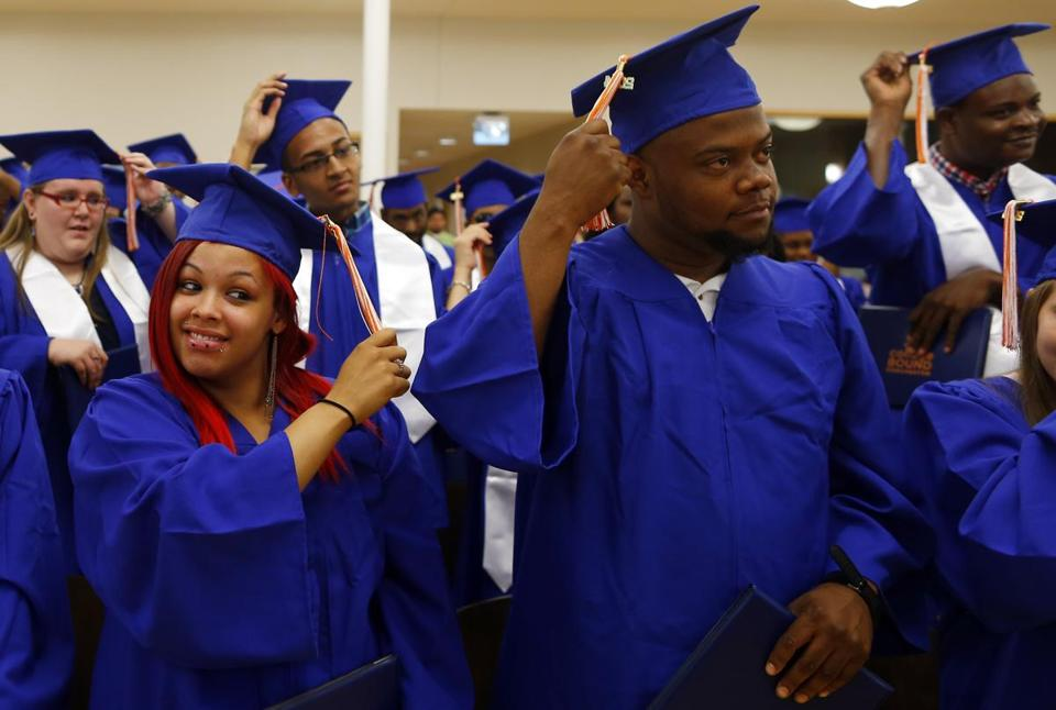 Xiomara Sarmiento, 23, and Robert Browne, 26, flipped their tassels at the end of the College Bound Dorchester ceremony.