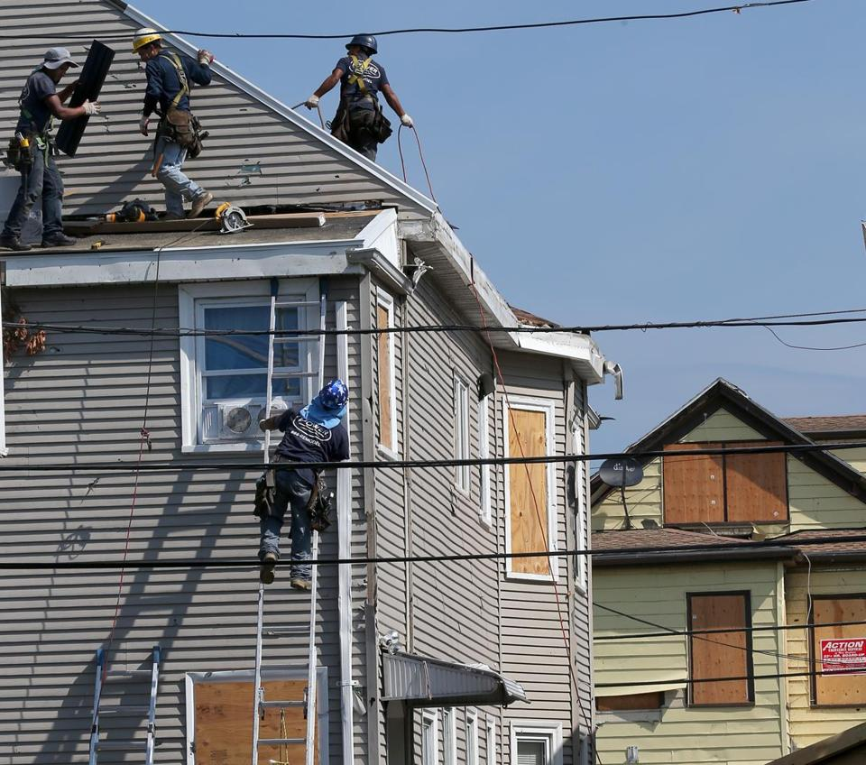 Repairs were underway on Wednesday to a house on Taft Street in Revere, but other residents were still negotiating with insurance companies following last month's tornado.