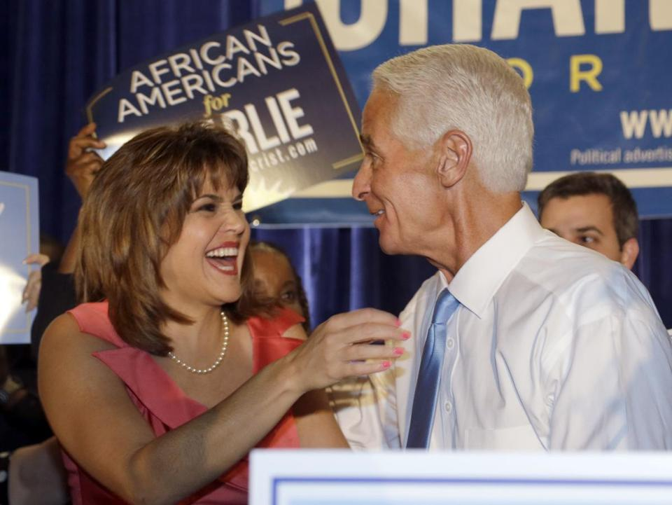 Former Florida governor Charlie Crist hugged his running mate, Annette Taddeo, at their victory party Tuesday night. (AP Photo/Wilfredo Lee)