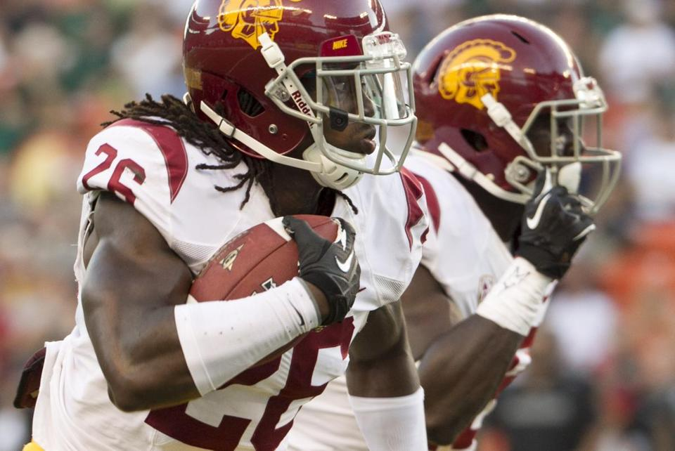 Josh Shaw (left) has been suspended indefinitely from all team activities. AP Photo/Eugene Tanner, File
