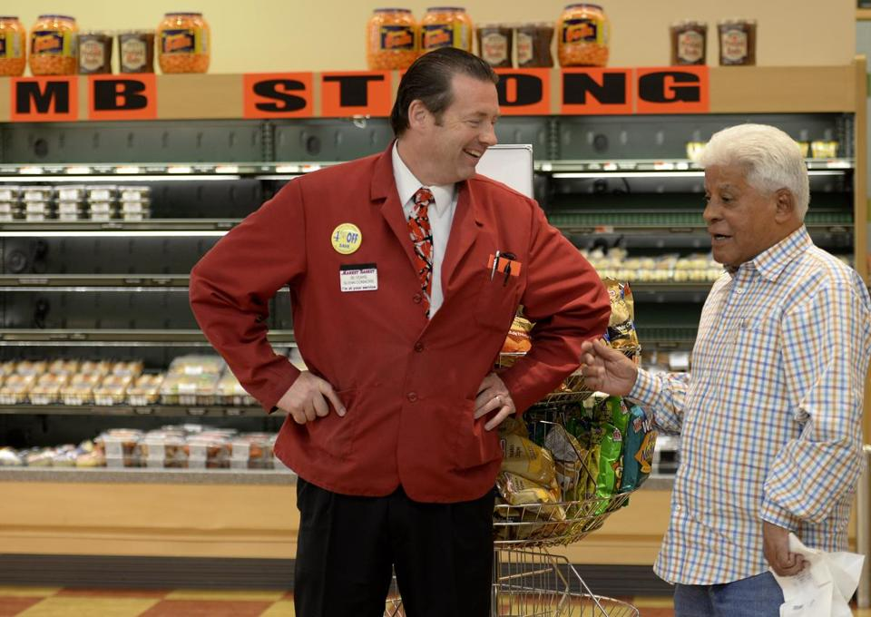 Brockton Market Basket manager Glenn Connors chats with  customer as the store returned to normal operations.