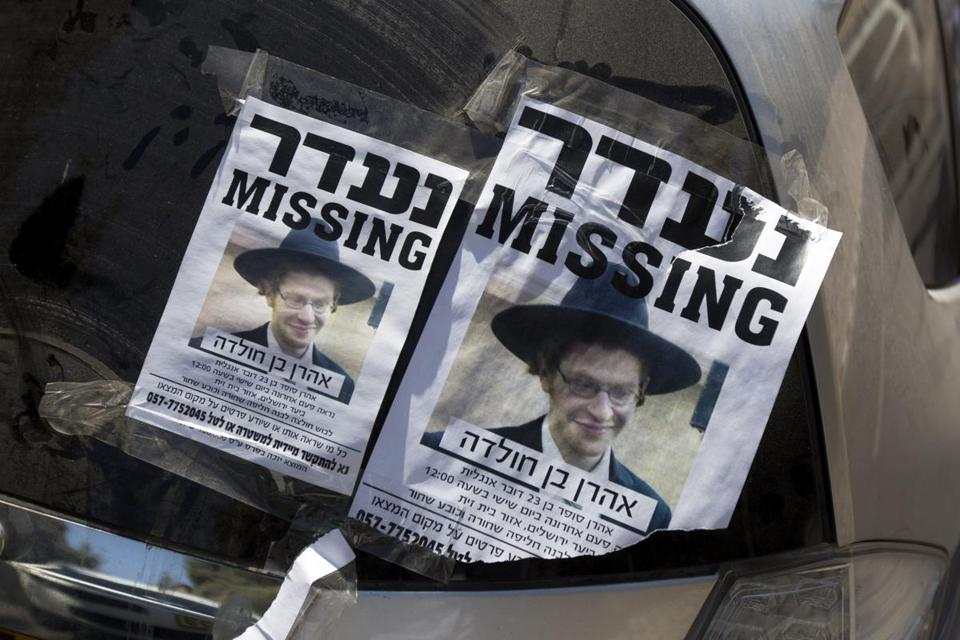 Posters showing a picture of Aharon Sofer were on display as volunteers searched for him. Authorities said a body believed to be Sofer has been found.