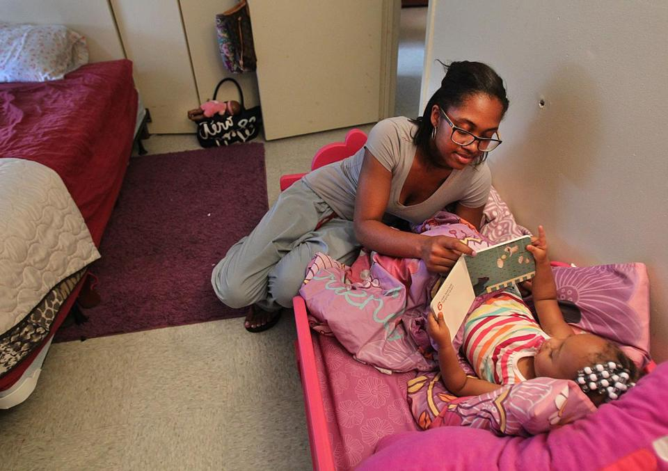 Stefanie Lawrence and her 2-year-old daughter, Destiny, at their home in Dorchester on Friday.