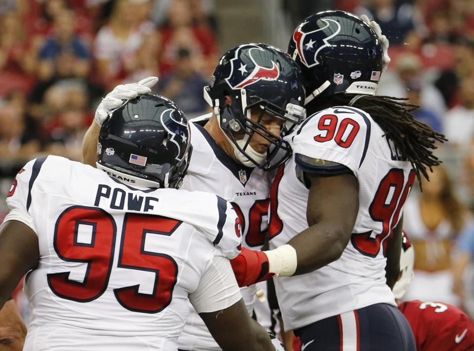 J.J. Watt, center, and Jadeveon Clowney, right, form the core of a talented Texans defense.