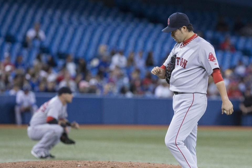 Junichi Tazawa was worked over again, giving up a three-run homer to Danny Valencia and the Blue Jays went on to beat the Sox. (AP Photo/The Canadian Press, Chris Young)