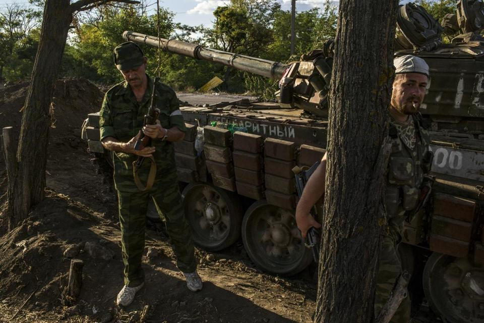 Troops identifying themselves as members of the New Russia Militia were encamped Friday in a Ukrainian border town.