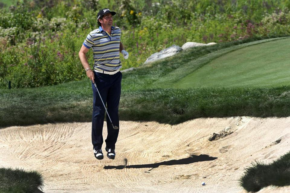 Keegan Bradley had to hop to see the pin from a bunker on 18, but he wound up with a birdie on the hole. Barry Chin/Globe Staff