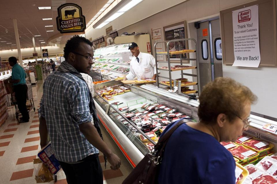Customers examined meat products at the Burlington Market Basket.