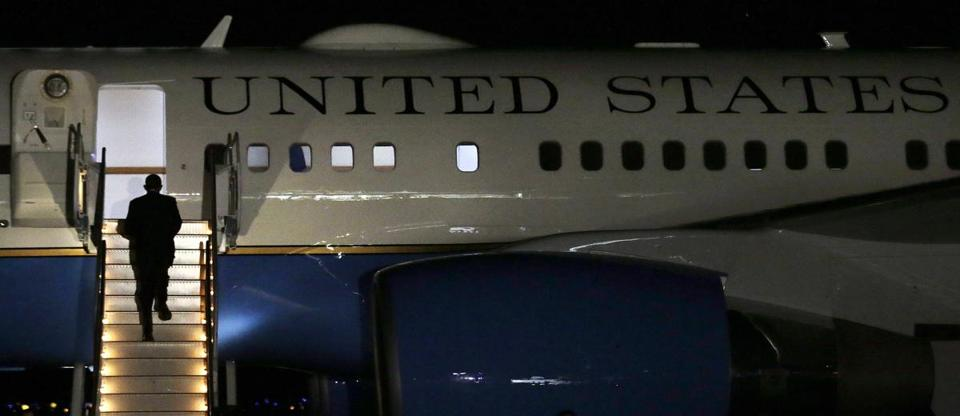 President Obama climbed a stairway to Air Force One before departing from T.F. Green Airport in Warwick, R.I., on Friday night.