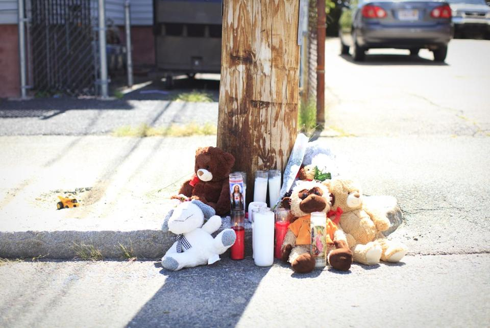 A makeshift shrine marked the spot where  a 3-year-old boy was struck and killed by a car in Brockton on Friday.