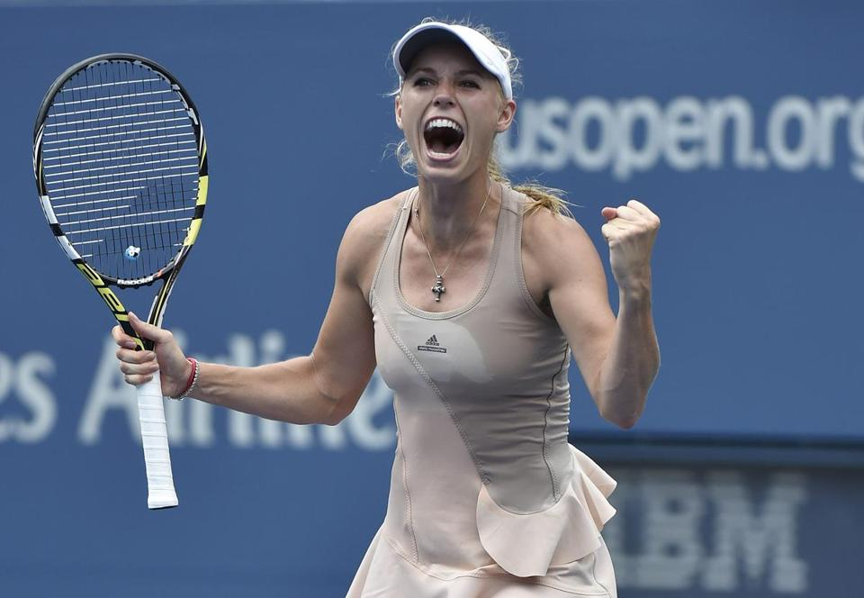 Caroline Wozniacki revels in the moment after upsetting Maria Sharapova at the US Open on Sunday. (John G. Mabanglo/EPA)