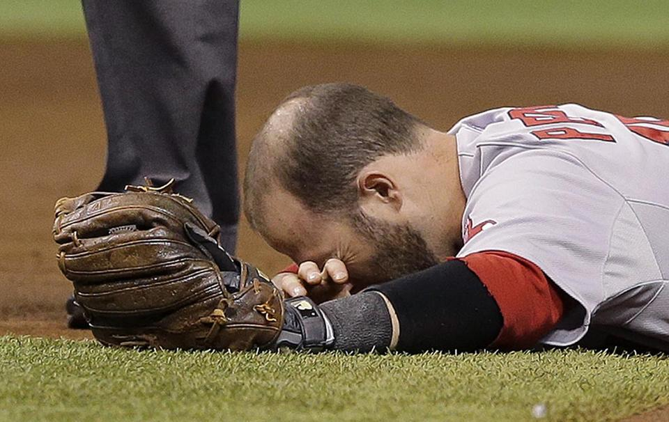 Dustin Pedroia sustained a concussion Saturday night, keeping him out of Sunday's game. Chris O'Meara/Associated Press