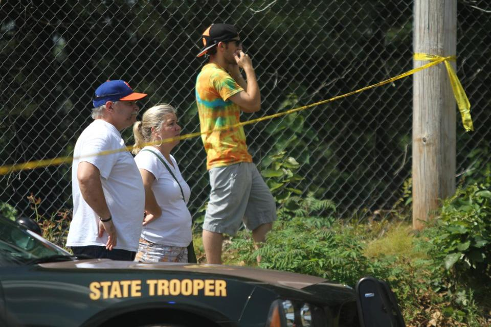 Spectators at the scene of a small airplane crash that killed two people in North Hampton, N.H.
